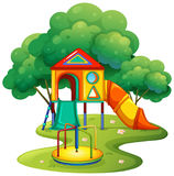 Playground with slide and roundabout Royalty Free Stock Images