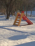 Playground with slide in wintertime Royalty Free Stock Photography