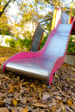 Playground slides in the park Stock Images
