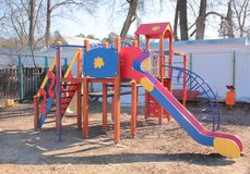 A Playground with slides on a Sunny day. In Spring without children Royalty Free Stock Photo