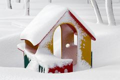 Playground with snow covered small children`s house in winter la Stock Photography