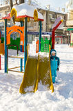 On the playground in the snowy Pomorie, Bulgaria, winter 2017 Royalty Free Stock Image
