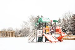 Playground in snowy winter park Royalty Free Stock Images