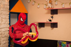 Playground with spiderman entertainer. Fixing funny balloons Stock Image