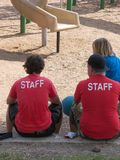 Playground Staff. Hot summer day at work stock photography