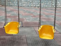 Playground swing Stock Images