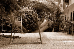 Playground Swing. Childen playing on Swing in Playground Royalty Free Stock Photos