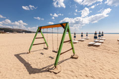 Playground swing on the beach Royalty Free Stock Photo