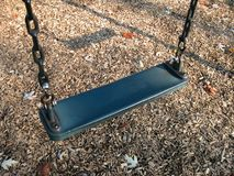 Playground Swing Closeup. Closeup of a swing on a sunny autumn afternoon stock photography