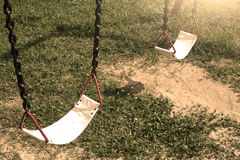 Playground swing lonely in the park and garden. Stock Photography