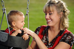 Playground Swing, Mother and Child Stock Photography