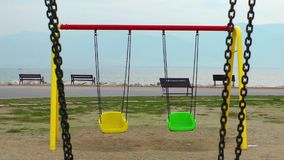 Playground Swing. The Swing in the playground near the seaside stock video
