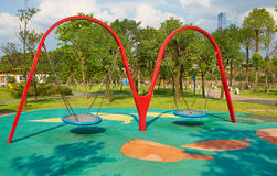 Playground with swing. Children kids playground with empty swings in school royalty free stock photos