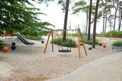 A playground with a swing Stock Photo