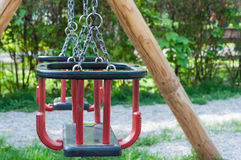 Playground swing set. In the park royalty free stock photos