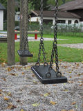 Playground swing set. Selective focus. Royalty Free Stock Photo