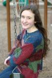 Playground swing smile Stock Photo