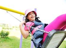 On the playground, swinging Royalty Free Stock Image
