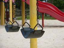 Playground and swings Stock Images