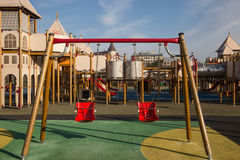 Playground swings in castle Stock Photo