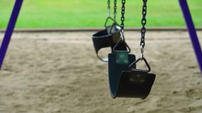 Playground Swings without children stock video footage