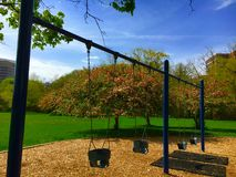Playground Swings. In a park Royalty Free Stock Images