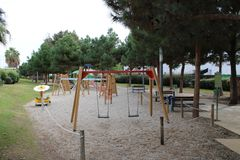 Playground with swings on sand royalty free stock photo