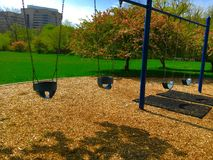 Playground Swingset. Playground swings in a park Royalty Free Stock Photos