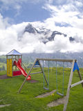 Playground with Swiss Alps background Stock Photos