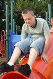 Playground Teen 4. Teenage boy on top of playground equipment royalty free stock photo