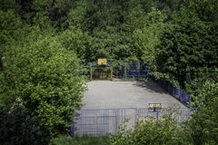 Playground. Thick green trees around  sports grounds for playing basketball Stock Photography