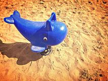 Playground toy. A ride at the park for children to play on, a blue whale, on a giant spring for Stock Images