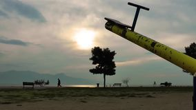 Playground and the Tree in the Sunset. The Playground and the Tree in the Sunset stock footage