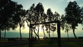 Playground and the Tree in the Sunset. The Playground and the Tree in the Sunset stock video