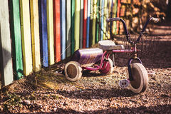 Playground Tricycle. Deserted rusty children's tricycle bike, at a playground Stock Image