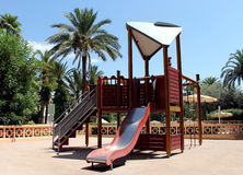 Playground in a tropical park Stock Image