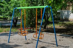 Playground on which children will find a bright rocker. Many bright colors make her joyful and attractive, so that the child wants stock photography