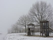 Playground with white frost in winter royalty free stock images