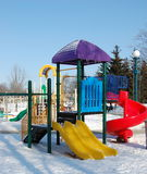 Playground in winter. Children's playground in winter snows Stock Photo