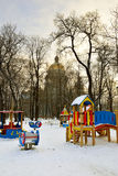 Playground in winter on a background of St. Isaac's Cathedral Royalty Free Stock Photo