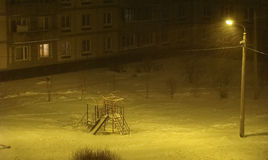 Playground winter evening. Swept snow during a blizzard Stock Photo