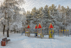 Playground in winter park Royalty Free Stock Photo