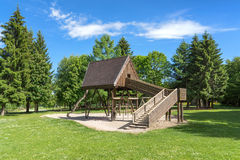 Playground with wooden house. Deserted playground with wooden house on a glade in the forest. Taken on the Rossberg above Albstadt in the Swabian Alps, Germany Royalty Free Stock Photo