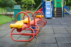 PlayGrounds Fun Zone happy. Totter in playground.fun and happy Royalty Free Stock Photos