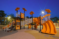 Playgrounds in garden. At night Royalty Free Stock Photos