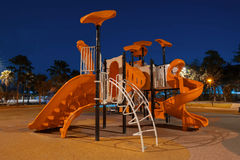 Playgrounds in garden. At night Royalty Free Stock Photo