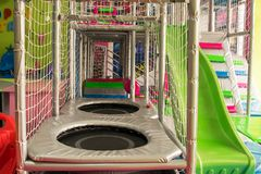 Playgrounds Maze With Slides, Trampolines, Climbers. Safety ropes ,cylinder Royalty Free Stock Images