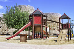 Playgrounds in park. Playground with a castle background of Manfredonia Royalty Free Stock Images