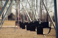 Playgroung swings. Lonely playground royalty free stock photo