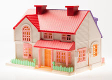 Playhouse. Dollhouse close up on a light background Royalty Free Stock Photography